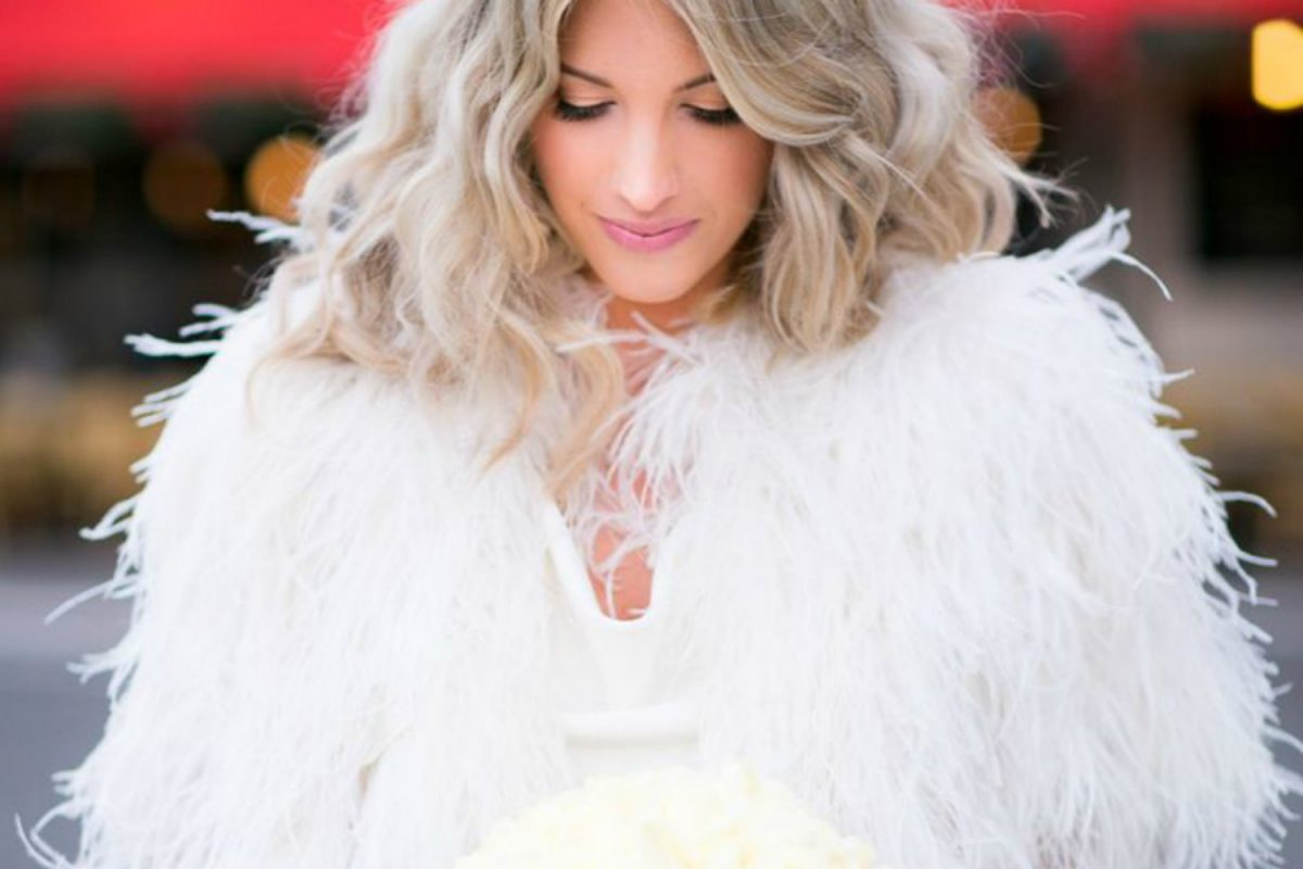 Bride wearing a feather bridal coat