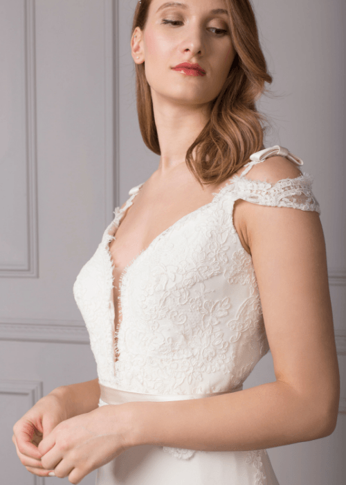 Elegant lace cap sleeved silk bridal gown