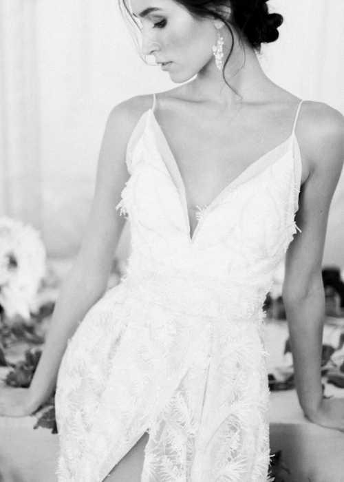 bride wearing a feather embroidered wedding dress
