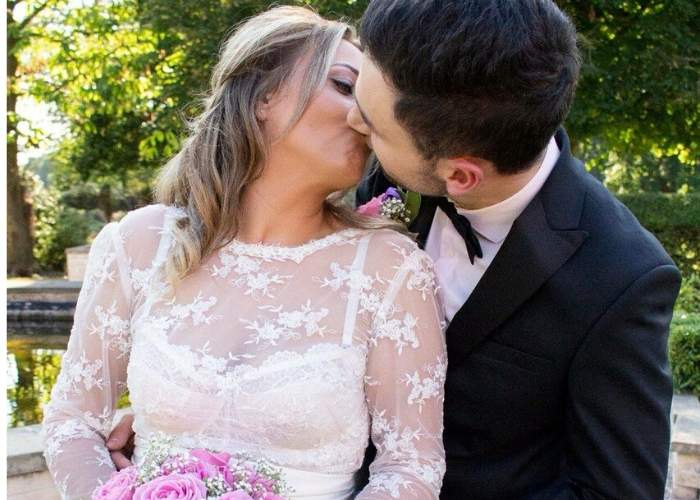 bride wearing A LACE BRIDAL TOP AND KISSING GROOM