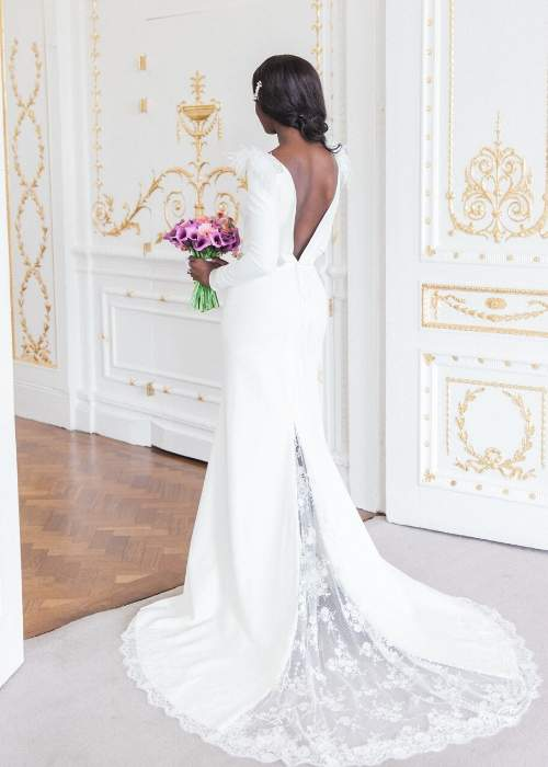 back view of a bride standing in doorway