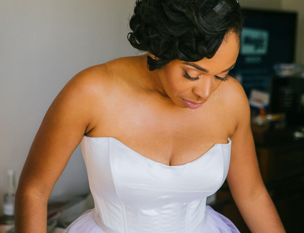 Black bride wearing a Timeless Couture designer wedding dress