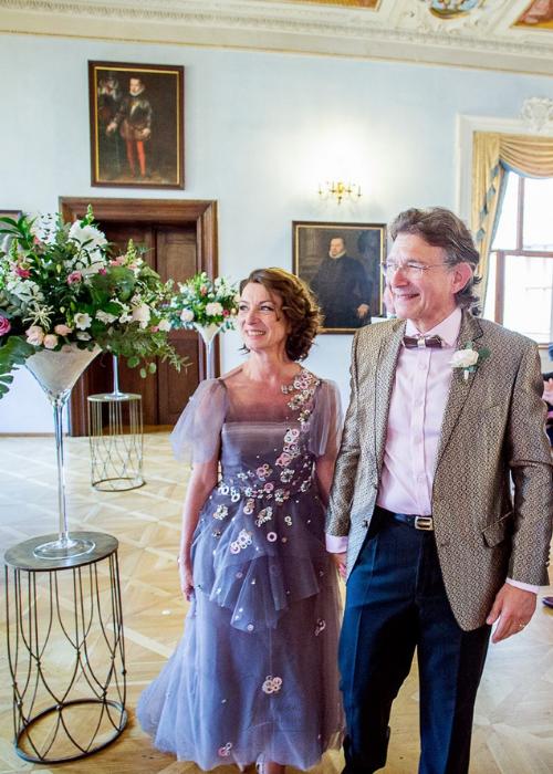 Bride wearing a grey tulle wedding dress