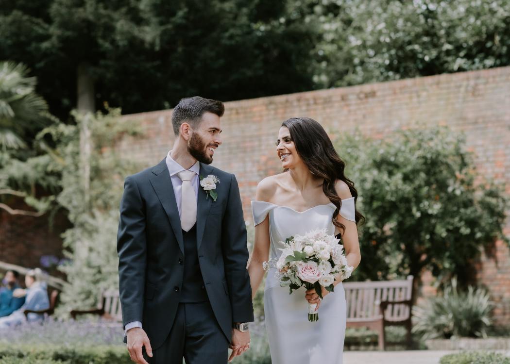 Bride wearing a cold shoulder wedding dress